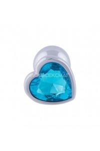 Серебристая анальная пробка с голубым кристаллом-сердцем - 7 см.